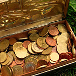 image of treasure chest with gold pieces